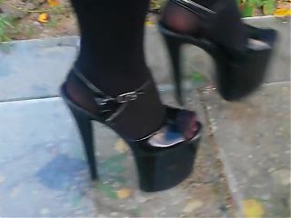Lady L walking xtreme high heels glas road.(video short ver)