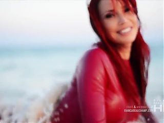 Sexy Red Latex Catsuit on the Beach