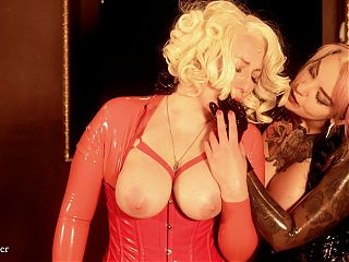 submissive pin-up girl and brunette latex mistress