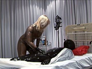 more fun in latex, she on top of a big cock