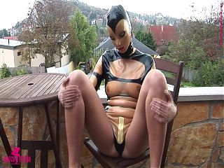 Sandra Shine wrapped in tight latex outdoors