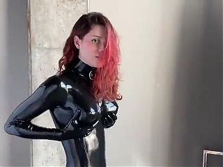 Fooling around in latex catsuit