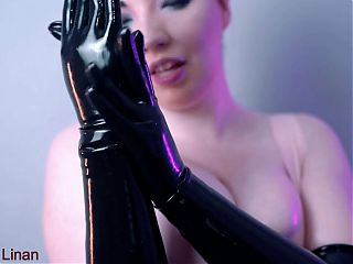 stroking her big tits with long latex gloves